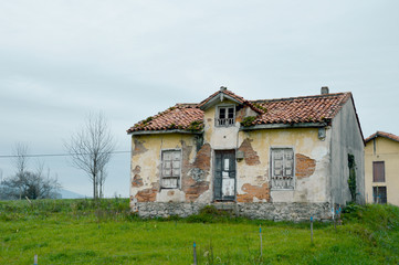 Old abandoned house, left and broken