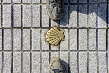 Symbol of the camino de santiago with two shoes of pilgrims