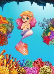 Beautiful mermaid in the deep blue sea