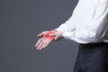 Pain in hand, joint inflammation, carpal tunnel syndrome on gray background
