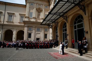 Pope Francis and President Mattarella listen to Italian national anthem during an official visit at the Quirinal Palace in Rome