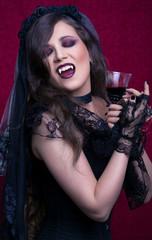 Halloween, portrait of a beautiful vampire woman