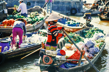 Unidentified people on floating market in Mekong river delta. Cai Rang and Cai Be markets are very popular among the local citizens and tourists.