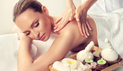 Massage and body  care. Spa body massage treatment. Woman having massage in the spa salon for...