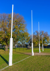 Four Australian Football goal posts in a suburban park in Melbourne Australia