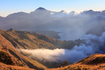 Cloudy and mist in sunset panorama view of Mountain Rinjani, active volcano at Lombok island of Indonesia