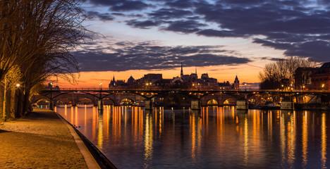 Sunrise on Ile de la Cite and the Seine River with view of Pont des Arts. 4th Arrondissement. Paris, France