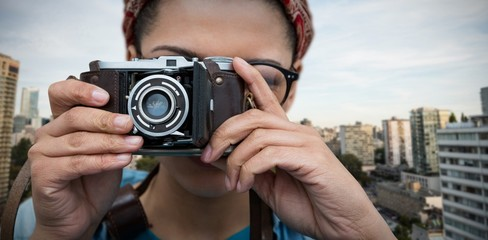 Composite image of close up of woman photographing with camera