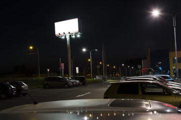 Illuminated billboard evening in the parking lot.