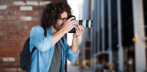 Composite image of professional male photographer taking picture