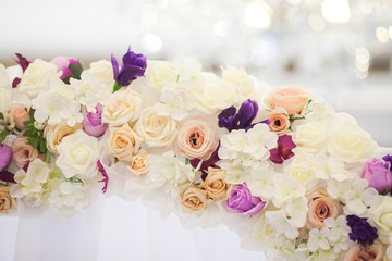 flower arch from fresh colors for a wedding ceremony closeup. wedding decor concept.