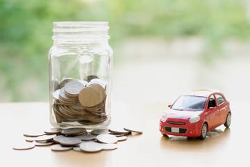 Money saving for Car installment in the glass bottle