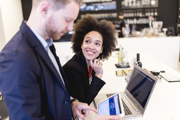 Multiracial business man and woman working together in modern office.