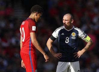 England's Dele Alli and Scotland's Scott Brown