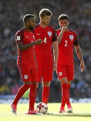 England's Eric Dier,  Kyle Walker and Ryan Bertrand prepare to take a free kick