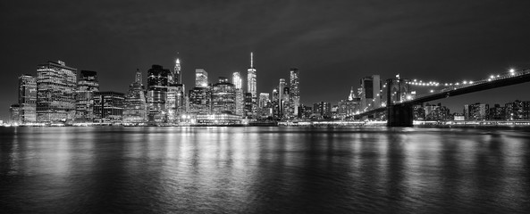 Black and white panoramic photo of Manhattan at night, New York City, USA.