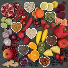 Paleolithic diet food of fresh fruit, vegetables, nuts and seeds on slate background. High in antioxidants, vitamins, anthocyanins and dietary fiber