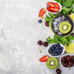 Ingredients healthy diet family meals: fresh juicy fruits and berries with mint and ice to prepare a healthy summer desserts, refreshing beverages, to add to cereal, for making smoothies on a light