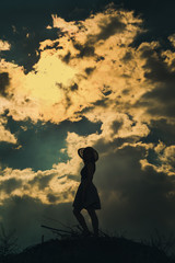 Silhouette girl at nature background