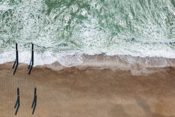Aerial view of Brighton Beach and posts from the West Pier