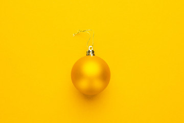 Christmas tree decoration ball on yellow background