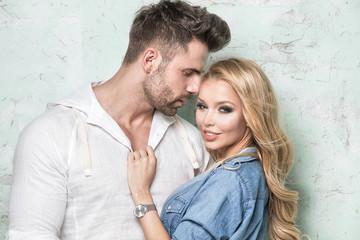 Beautiful couple posing in studio.