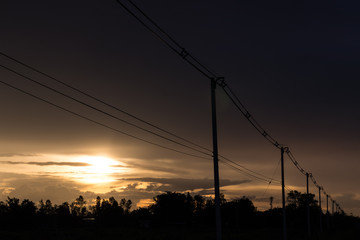 Power poles in the evening in the countryside.