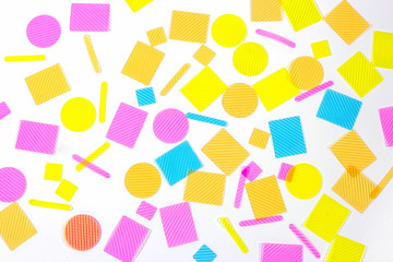 Plastic shapes pieces on white background