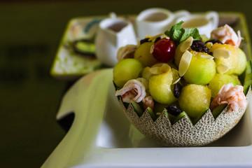 Delicious fresh melon salad served in melon bowl
