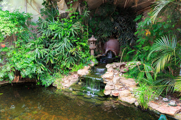 Small waterfall in decorative pond