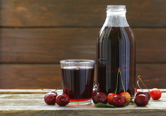 Organic cherry juice with fresh berries on the table