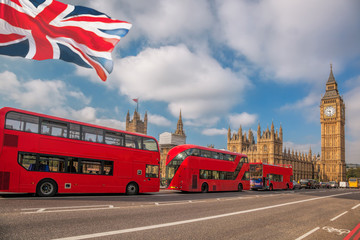 Foto auf Leinwand London roten bus London with red buses against Big Ben in England, UK