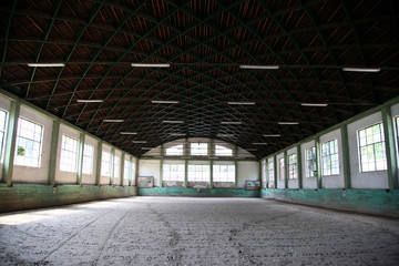 Abandoned riding hall without horses and horsemen