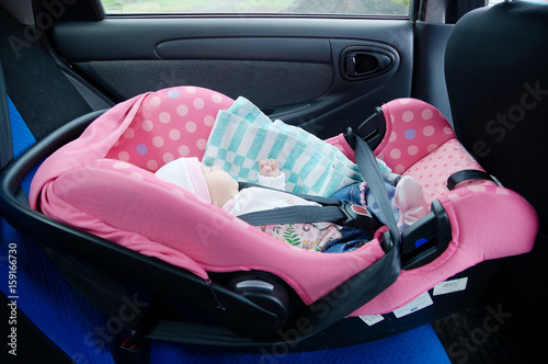 Newborn Sleeping In Car SeatSafety Concept Infant Baby Girl Secure Driving With