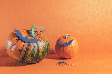 Halloween home decorations on orange background