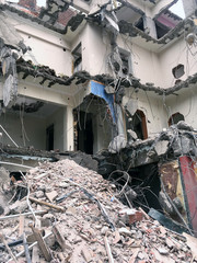close-up of building demolition after earthquake