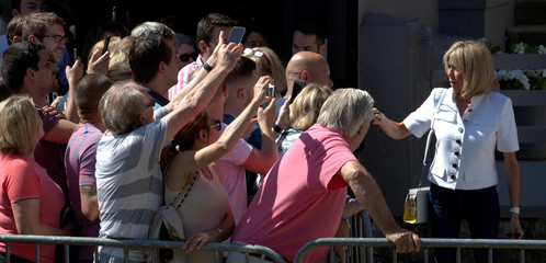 French President Emmanuel Macron's wife Brigitte greet supporters before voting in parliamentary elections in Le Touquet