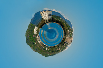 spherical panorama of a house by the sea under the clouds