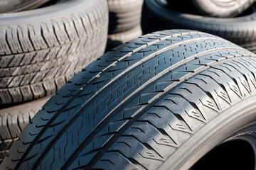 Close up of tread used car tires.
