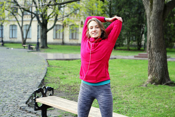 Woman warming up before training, smiling