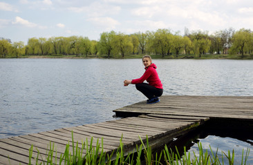 Woman on pier, near water, river background, outdoor, nature