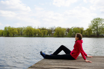 Girl resting on nature, near river