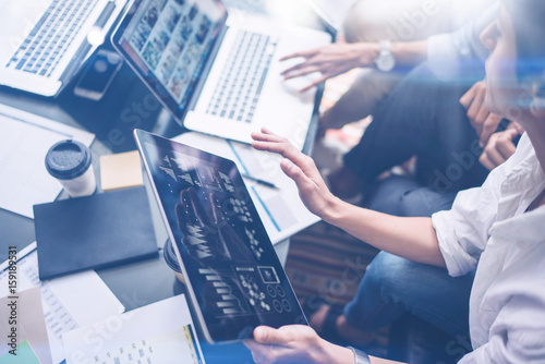 Young Coworkers Working On Laptop Computer At Office Woman