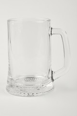 Empty beer glass isolated. Clear beer container, white background.