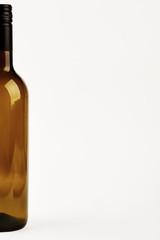 Half of dark bottle isolated. Cropped image of glass bottle.