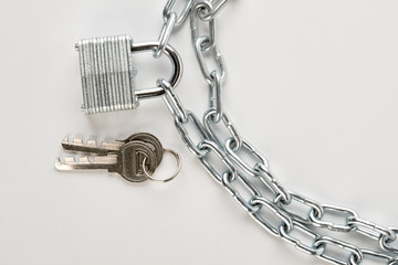 Padlock attached to silver chain. Concept of enclosed justice. Unlock your freedom.