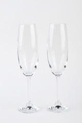 Two champagne glasses, front view. Crystal clear glasses for wine.