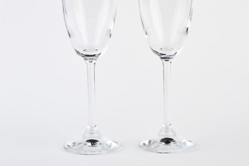 Two wine glasses, cutted image. Couple goblets on white background.