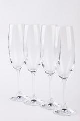 Set of champagne glasses. Four empty glasses, white background.