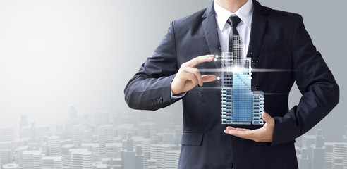 business man create design modern building